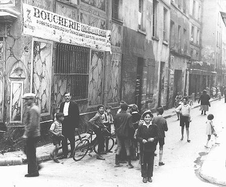 "<p>Street scene in the Jewish quarter of <a href=""/narrative/6033"">Paris</a> before World War II and the Holocaust. Paris, France, 1933–39.</p>"