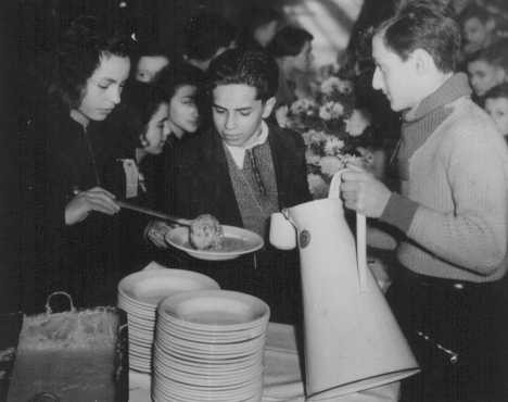 <p>Jewish refugee children, who are members of the first Kindertransport from Germany, eat a meal at the Dovercourt Bay holiday camp near Harwich, England.</p>