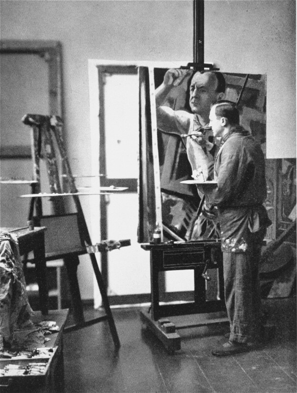 Georg Grosz, a Communist satirical artist and painter, seen here in his studio in Berlin. [LCID: 66021]