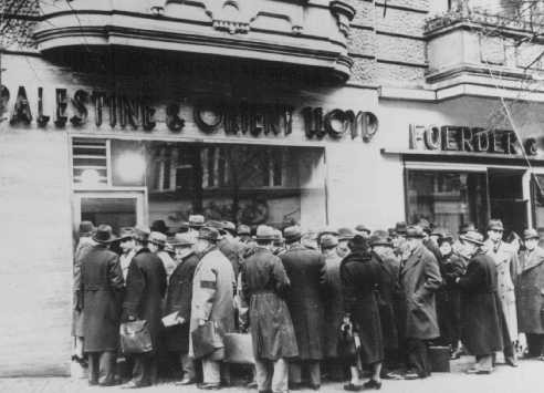 "<p>German Jews trying to <a href=""/narrative/6473"">emigrate</a> to Palestine form long lines in front of the Palestine and Orient Travel Agency. Berlin, Germany, January 22, 1939.</p>"