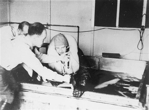 "<p>A victim of a <a href=""/narrative/3000"">Nazi medical experiment</a> is immersed in icy water at the <a href=""/narrative/4391"">Dachau</a> concentration camp. SS doctor Sigmund Rascher oversees the experiment. Germany, 1942.</p>"