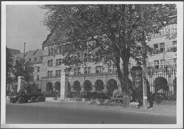 An armored car parked outside the gate of the Palace of Justice in Nuremberg on the day the judgement of the International Military Tribunal was handed down.