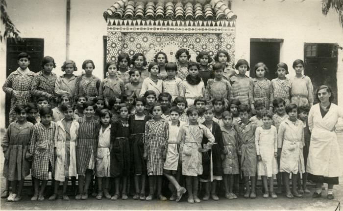 <p>Laurette Cohen (front row, far right) poses with her students at an Alliance Israelite School in Morocco. 1935. </p>