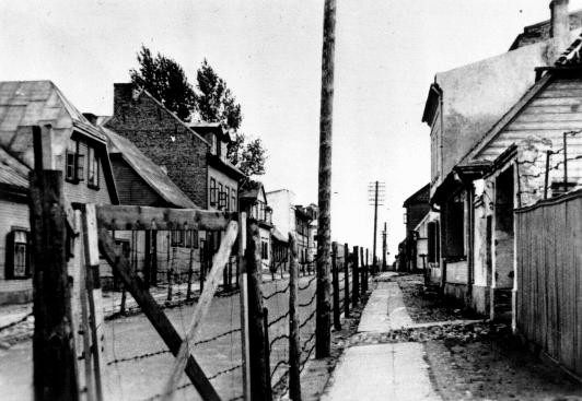 <p>Entrance gate to the Riga ghetto. This photograph was taken from outside the ghetto fence. Riga, Latvia, 1941-1943.</p>