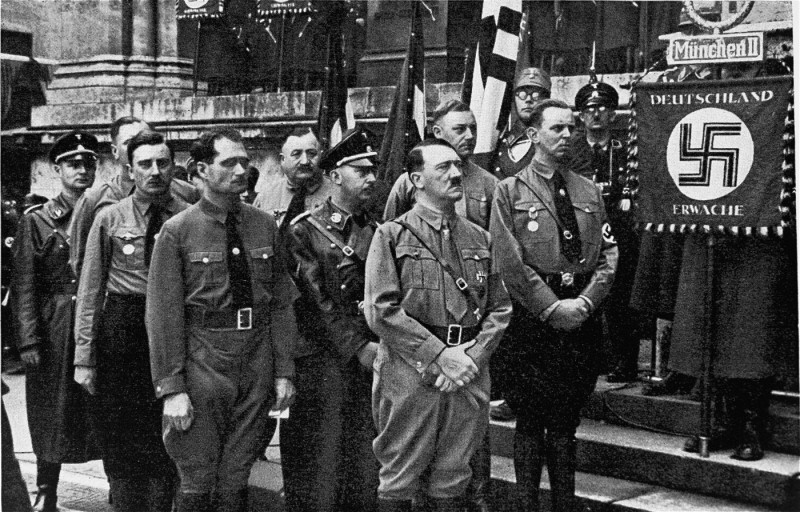 "<p>Adolf Hitler and other participants in the Hitler Putsch, during the annual anniversary celebration of his failed attempt to seize power. Behind Hitler stand Rudolf Hess (left) and <a href=""/narrative/10813/en"">Heinrich Himmler</a>. Munich, Germany, November 9, 1934.</p>"