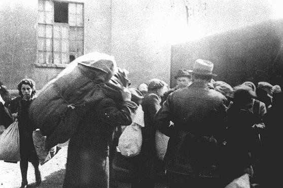 <p>Jews from Bulgarian-occupied Macedonia who were rounded up and assembled in the Tobacco Monopoly transit camp in Skopje prepare to board deportation trains. Skopje, Yugoslavia, March 1943.</p>