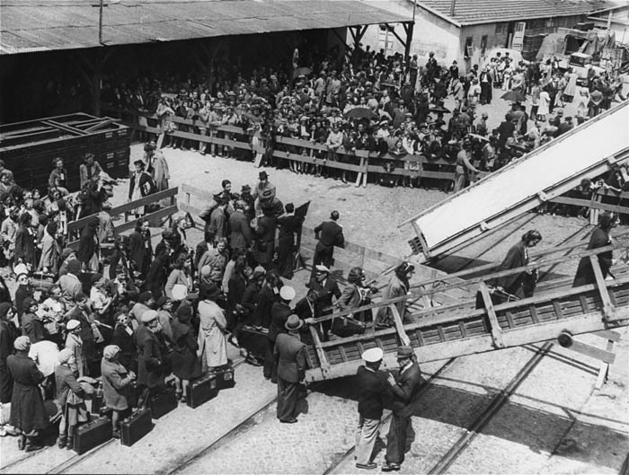Jewish refugees board the SS Mouzinho for the voyage to the United States. [LCID: 06526]