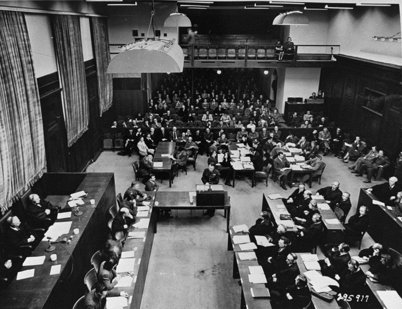 "<p>US Brigadier General Telford Taylor, chief counsel for war crimes, opens <a href=""/narrative/9569"">The Ministries Trial</a> by reading the prosecution's opening statement. He charges Hitler's ministers with ""crimes against humanity."" Nuremberg, Germany, January 6, 1948.</p>"