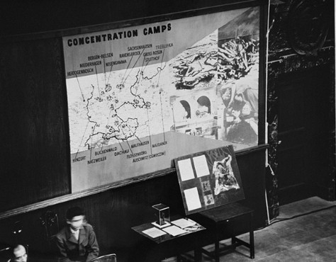 Photographs, artifacts, and a map presented as evidence at the International Military Tribunal. [LCID: 10407]