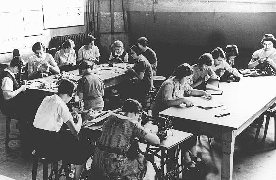 Girls in a sewing class at the Adas Israel school, maintained by the German Jewish community. [LCID: 76818]