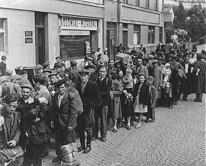 "<p>Jewish <a href=""/narrative/6365"">refugees</a>, part of <a href=""/narrative/5217"">Brihah</a>—the postwar flight of Jews—in line at a relief center. They are en route to the Allied occupation zones in Germany and Austria. Nachod, Czechoslovakia, 1946.</p>"