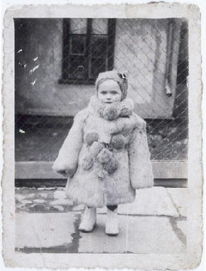 <p>Portrait of three-year-old Estera Horn wrapped in a fur coat. Chelm, Poland, ca. 1940.</p>