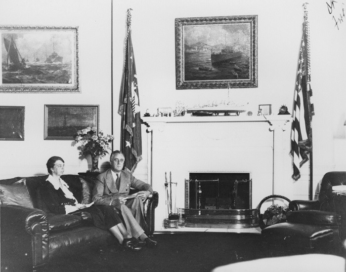 <p>President Franklin D. Roosevelt sits with Eleanor Roosevelt in his study in the White House. Washington, DC, 1933.</p>