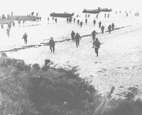 British troops land on the beaches of Normandy on D-Day, the beginning of the Allied invasion of France to establish a second front ... [LCID: 04735]