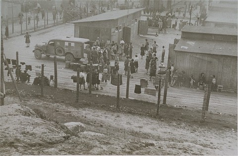<p>Survivors, American soldiers, and Red Cross workers at the Mauthausen concentration camp. Mauthausen, Austria, after May 5, 1945.</p>