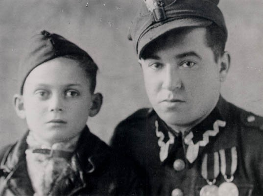 Thomas (left), 6 months after liberation, with a soldier who realized that Thomas was Jewish and took him to an orphanage, ca. [LCID: buerg18]