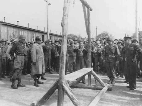 A Dutch survivor shows Generals Eisenhower, Patton, and Bradley the gallows at the Ohrdruf camp.