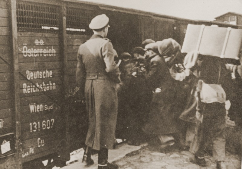 "<p>Jews are forced into boxcars for deportation to the <a href=""/narrative/3769/en"">Belzec</a> killing center. Lublin, Poland, 1942.</p>"