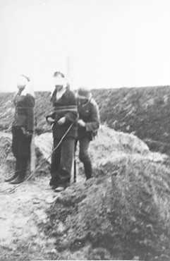 As part of systematic reprisals for deaths of German soldiers and ethnic German civilians during the invasion of Poland, German army troops execute Poles in Cycow, Poland, in September 1939.