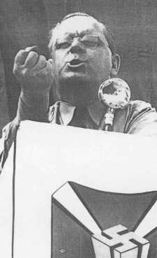 <p>Fritz Kuhn, head of the antisemitic and pro-Nazi German American Bund, speaks at a rally. United States, between 1936 and 1939.</p>