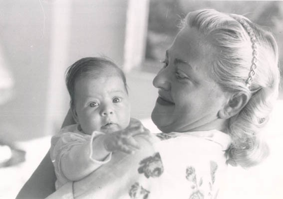 "<p><a href=""/narrative/10265"">Norman</a>'s daughter, Esther, at three weeks of age, with her mother, Amalie. September 1956.</p>