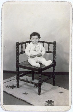 "<p>Portrait of Tsewie Herschel seated in a chair, taken while he was living in <a href=""/narrative/7711"">hiding</a>. Oosterbeek, the Netherlands, 1943–1944.</p>