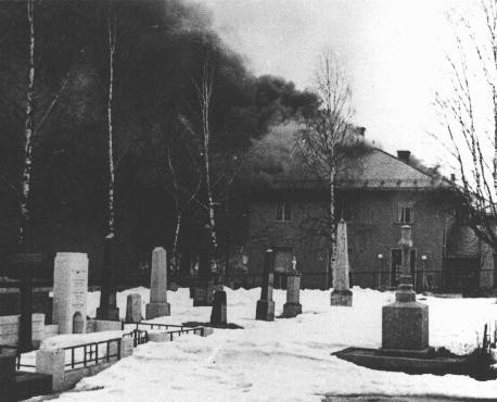 """<p>The Norwegian town of Elverum, near the Swedish border, burns after a German bombing mission during the invasion of Norway. Elverum, <a href=""""/narrative/6313/en"""">Norway</a>, May 3, 1940.</p>"""