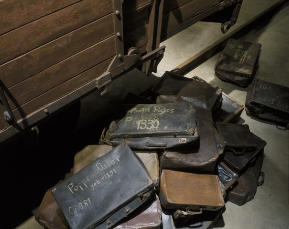 "<p>A collection of valises belonging to Jews who were <a href=""/narrative/5041"">deported to killing centers</a>. These valises are displayed at the base of the railcar on the third floor of the Permanent Exhibition at the United States Holocaust Memorial Museum. Washington, DC, 1993–1995.</p>"