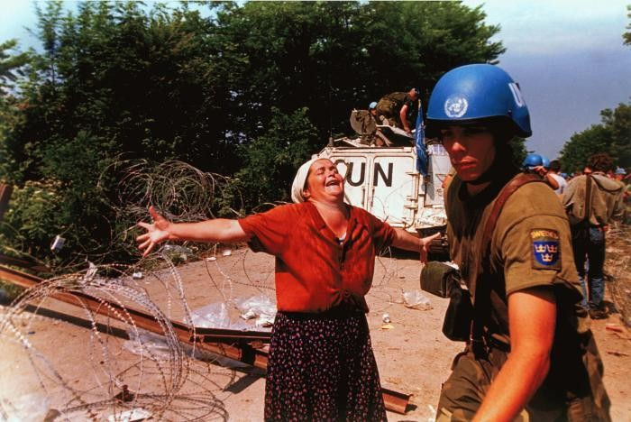 <p>In July 1995, Bosnian Serb forces killed as many as 8,000 Bosniaks from Srebrenica. It was the largest massacre in Europe since the Holocaust. This photograph showsa Bosniak woman at a makeshift camp for people displaced from Srebrenica in July 1995.</p>