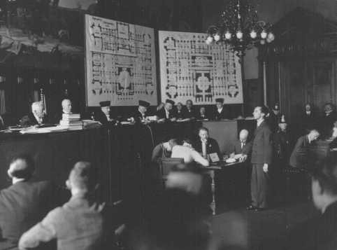 <p>Joseph Goebbels (standing) testifies for the state during the Reichstag Fire Trial before the Supreme Court. Leipzig Germany, 1933.</p>