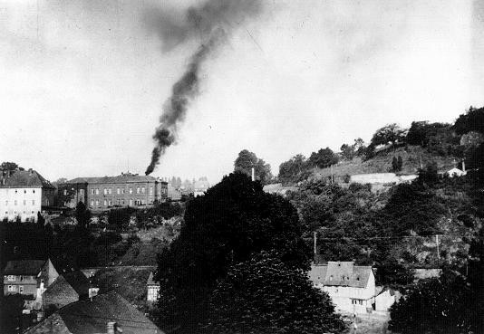 Smoke rising from the chimney at Hadamar, one of six facilities which carried out the Nazis' Euthanasia Program. [LCID: 86721a]