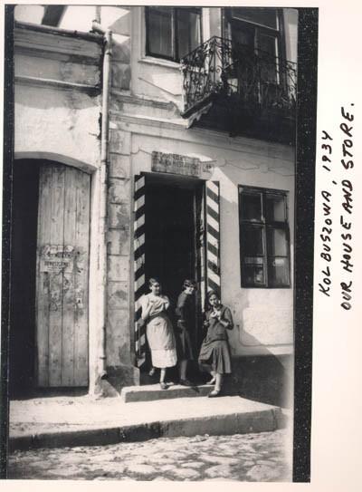 Norman's sisters Malcia, Matla, and Rachel eat bagels in the doorway of their mother's store.