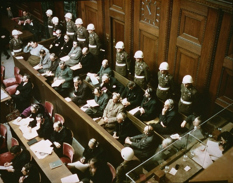 "<p>View of the <a href=""/narrative/9934/en"">defendants</a> in the dock at the International Military Tribunal trial of war criminals at Nuremberg. November 1945.</p>"