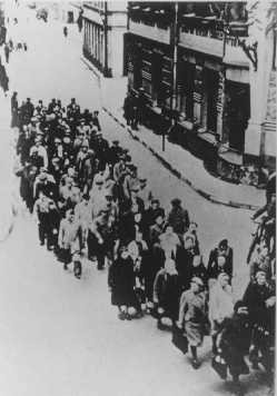 "<p>Jews from the Riga ghetto on the ""Aryan"" side of Riga. Some groups of Jews were taken outside the ghetto for forced labor. Riga, Latvia, between 1941 and 1943.</p>"