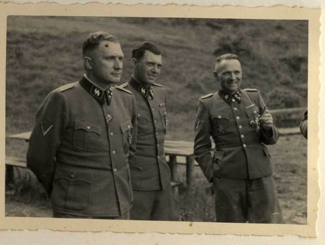 Richard Baer, Dr. Josef Mengele, and Rudolf Höss. [LCID: 34753]