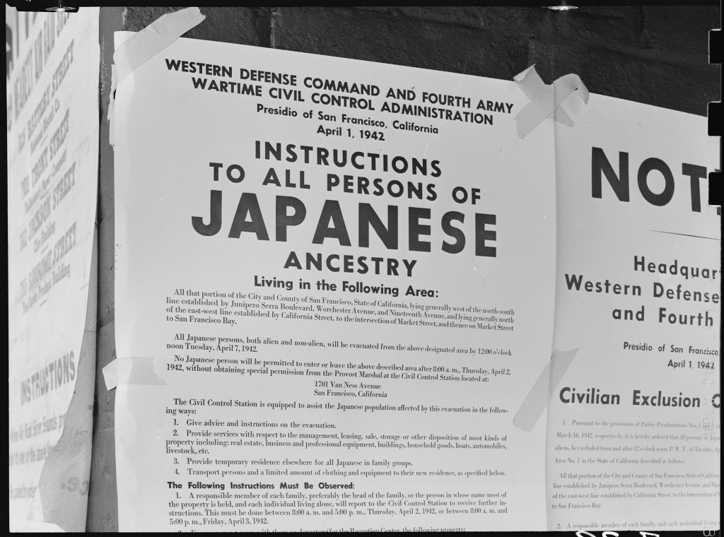 """A notice posted on a wall in San Francisco, California, lists """"evacuation"""" instructions for the area's Japanese American residents, 1942.   Japanese Americans were deported, first to temporary """"assembly centers,"""" and from there to relocation centers in remote areas of the United States."""