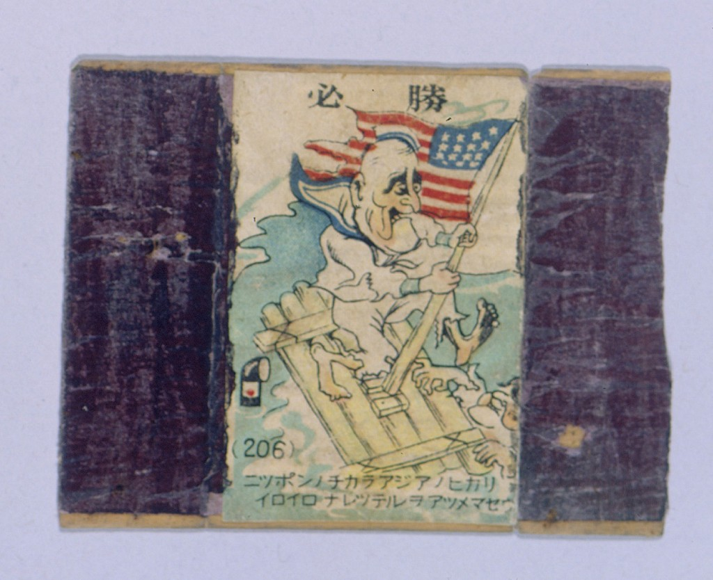 """<p>During the war the Japanese flooded Shanghai with anti-American and anti-British propaganda, including this image from a matchbox cover. It depicts United States President Franklin D. Roosevelt--dressed in rags, on a raft in the ocean, and holding onto the U.S. flag--in the view of a Japanese submarine periscope. Shanghai, China, between 1943 and 1945. [From the USHMM special exhibition <a href=""""/narrative/10592"""">Flight and Rescue</a>.]</p>"""