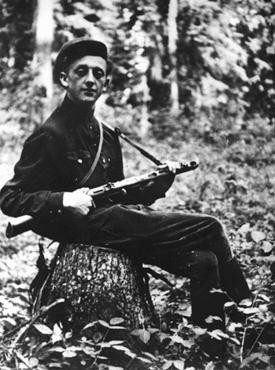 Eliezer Zilber, a member of the Kovno ghetto resistance, poses in the forested area where he fought as a partisan. [LCID: 04274]