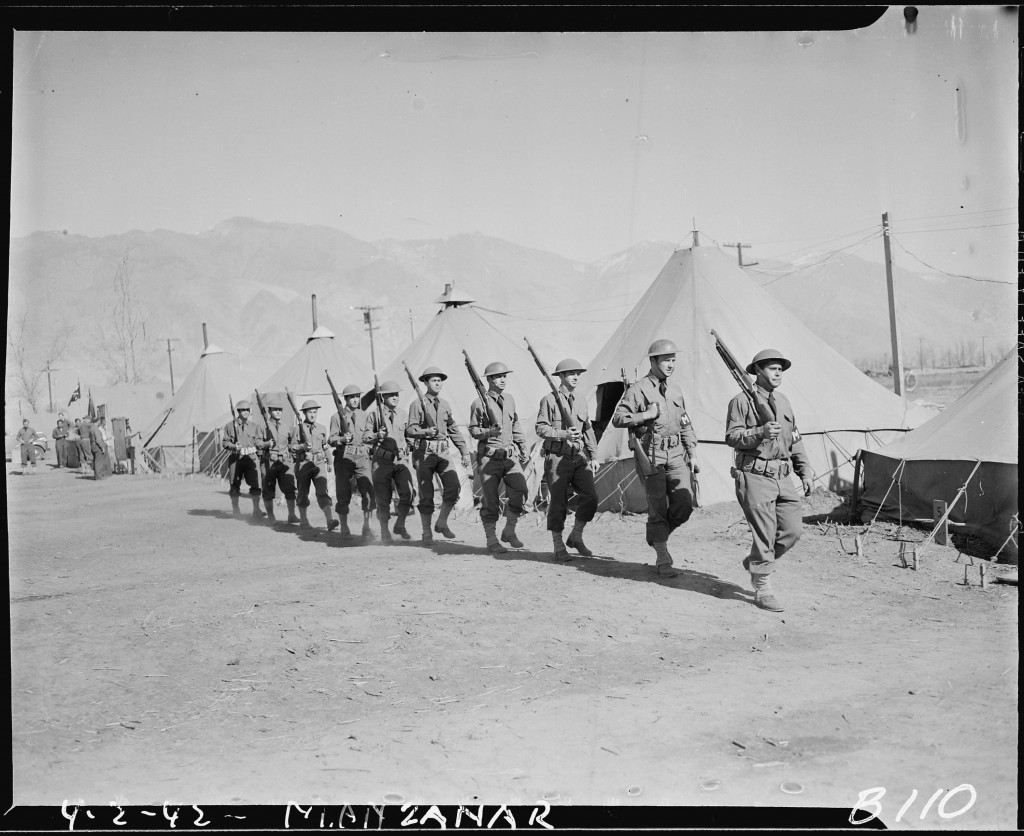 "<p><span style=""font-weight: 400;"">Army Military Police guarding the boundaries of the Manzanar Relocation Center in California, one of ten <a href=""/narrative/32232/en"">relocation</a> camps where American residents of Japanese ancestry were forcibly deported, April 2, 1942.</span></p>"