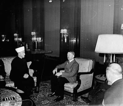 The former Mufti of Jerusalem, Hajj Amin al-Husayni, meets Hitler for the first time. [LCID: hof42552]