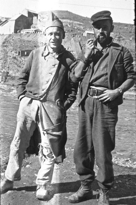 Close-up portrait of two prisoners in the Im Fout labor camp in Morocco.