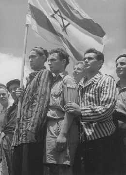 """<p>Concentration camp survivors aboard the Aliyah Bet (""""illegal"""" immigration) ship """"Mataroa"""" arrive at the Haifa port. The British denied them entry and deported them to Cyprus detention camps. Palestine, July 15, 1945.</p>"""