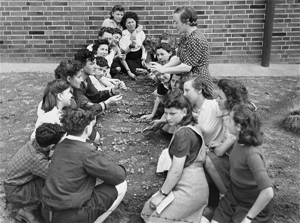 Jewish youth attend a class on transplanting seedlings, part of a general course in farming sponsored by the American Jewish Joint ... [LCID: 00819]