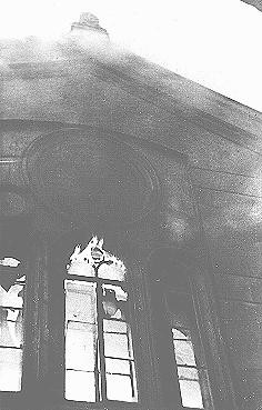 "The Neue Weltgasse synagogue burns during the Kristallnacht (""Night of Broken Glass"") pogrom. [LCID: 12315]"