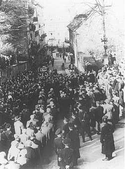 """After the Kristallnacht (""""Night of the Broken Glass"""") pogrom, German civilians line the streets to watch the forced march of Jewish ... [LCID: 4387]"""