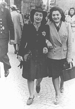 Rozetta Lezer Lopesdias-Van Thyn, left, and a friend, with the compulsory Star of David on their clothing.