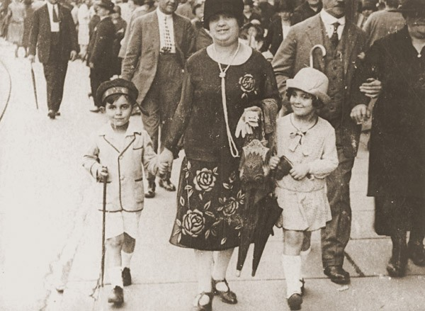 <p>Simone Weil (right), her mother Jeanne, and her brother Roger stroll along a street in Strasbourg. France, 1926.</p>