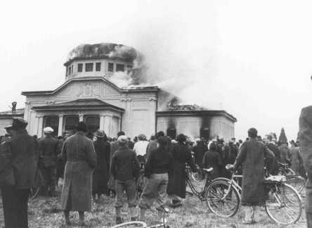 "Local residents watch  the burning of the ceremonial hall at the Jewish cemetery in Graz during Kristallnacht (the ""Night of Broken ... [LCID: 4372]"