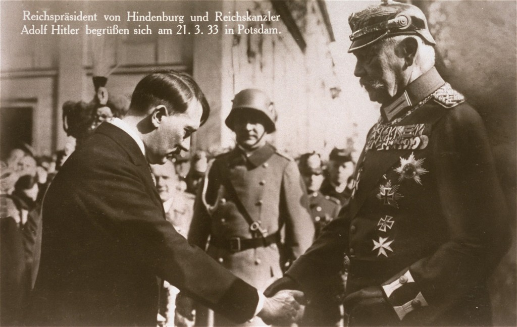 Recently appointed as German chancellor, Adolf Hitler greets President Paul von Hindenburg in Potsdam, Germany, on March 21, 1933. [LCID: 78587]