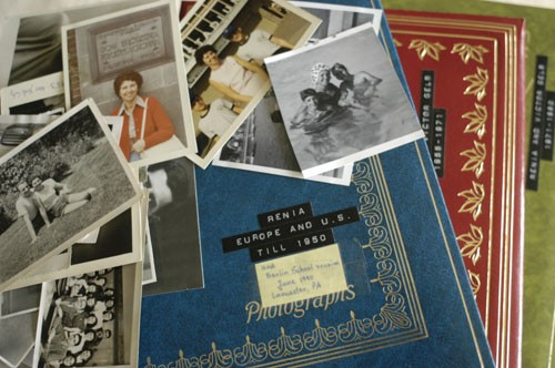 "<p>Stack of <a href=""/narrative/10466"">Regina Gelb</a>'s photographs and albums. 2004.</p>"